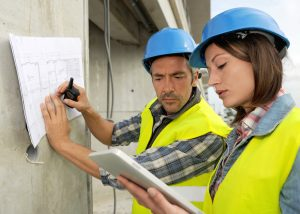 site engineers with schematic